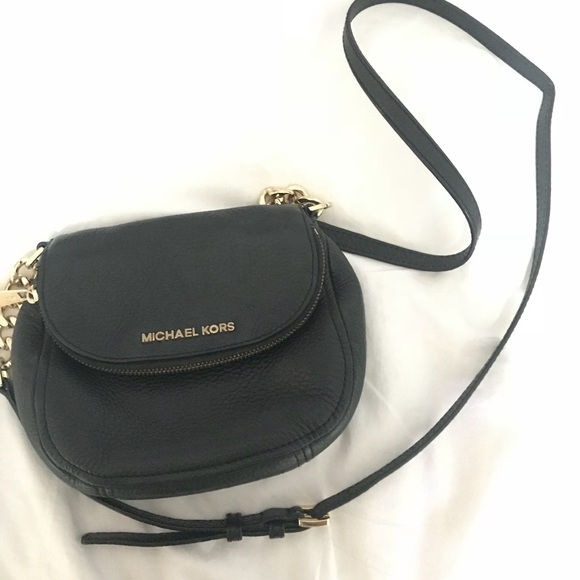 440f2bf4d2db Michael Kors Black crossbody w/ gold chain detail.  M_5b6caa79283095ac912c5f1b. Other Bags ...